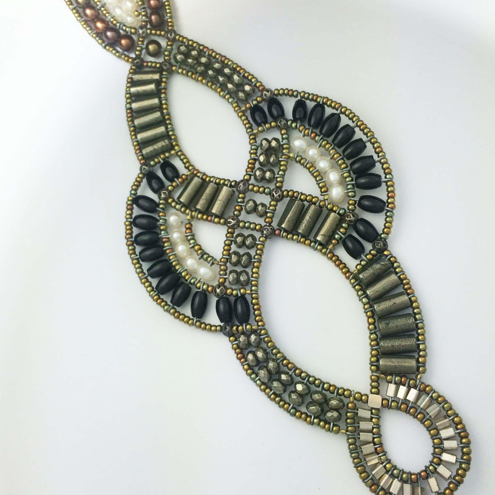 Handmade italian cuff with pyrite, pearls,murano glass and semi precious stones