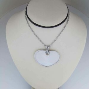 18k mother of pearl heart with a diamond cage