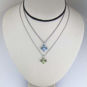 18k dainty semi precious cross necklaces ...one blue topaz and one peridot