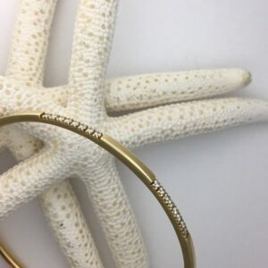 18k white gold bangle with diamond stations