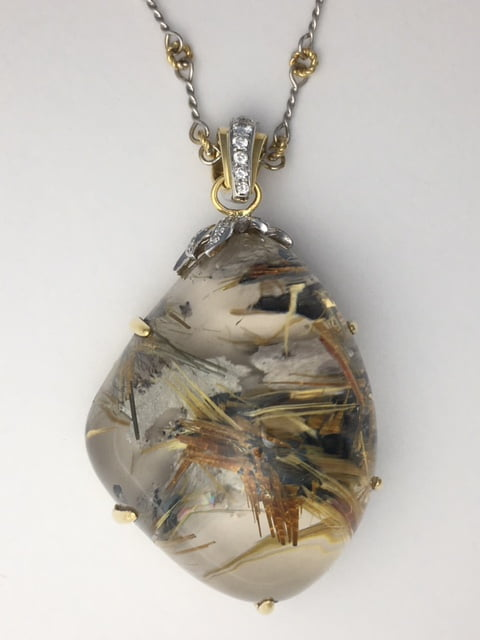 One of a kind necklace with amazing Rutilated Quartz set in 18k and diamonds. The chain is completely handmade and is 18kt white and yellow gold